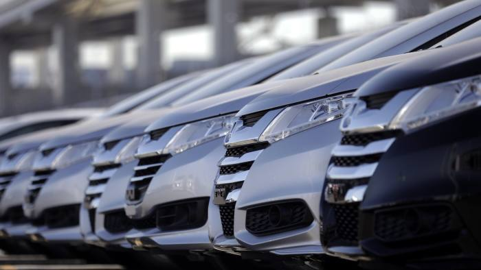 Honda Motor Co. vehicles bound for shipment sit parked in a lot at a pier in Yokohama, Kanagawa, Japan, on Thursday, Jan. 26, 2017. Japanese Prime Minister Shinzo Abe signaled that he's open to a bilateral trade deal with the U.S. after Donald Trump formally withdrew from a 12-nation Asia-Pacific accord this week in one of his first acts as president. Photographer: Kiyoshi Ota/Bloomberg