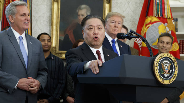 House Majority Leader Kevin McCarthy, R-Calif., and President Donald Trump listen as Broadcom CEO Hock Tan speaks during an event to announce the company is moving its global headquarters to the United States, in the Oval Office of the White House, Thursday, Nov. 2, 2017, in Washington. (AP Photo/Evan Vucci)