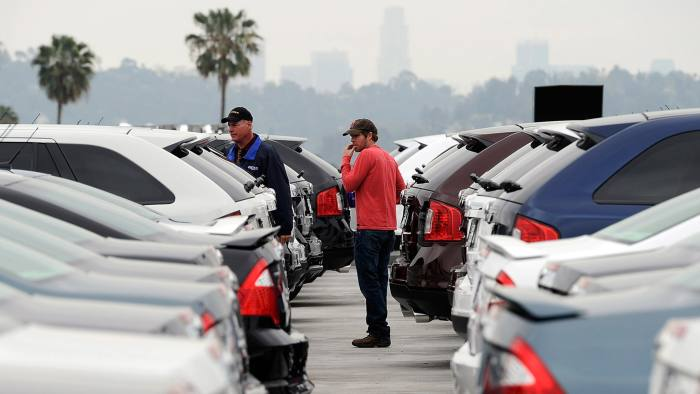 GLENDALE, CA - MARCH 23: Allen Zimney and his girlfriend Leila Alvarez, with the help of Star Ford salesman Greg Bowles, shop for a Ford Edge at the Star Ford dealership on March 23, 2012 in Glendale, California. New car sales in March are expected to top 1.4 million in the U.S., on pace for 14.6 million within the year. (Photo by Kevork Djansezian/Getty Images)
