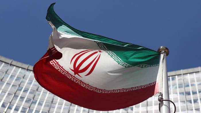 An Iranian flag flutters in front of the UN headquarters in Vienna...An Iranian flag flutters in front of the United Nations headquarters in Vienna June 17, 2014. Six world powers and Iran began their fifth round of nuclear negotiations on Tuesday in hopes of salvaging prospects for a deal over Tehran's disputed atomic activity by a July deadline. REUTERS/Heinz-Peter Bader (AUSTRIA - Tags: POLITICS ENERGY)