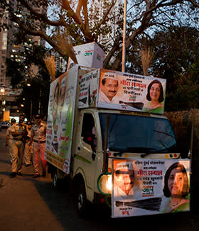 An AAP campaign truck on the streets of Mumbai, adorned with the brooms that symbolise the party's mission to sweep away corruption