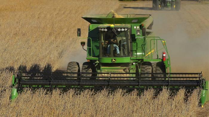 A central Illinois farmer harvests his soyabean field. (AP Photo/Seth Perlman, File)