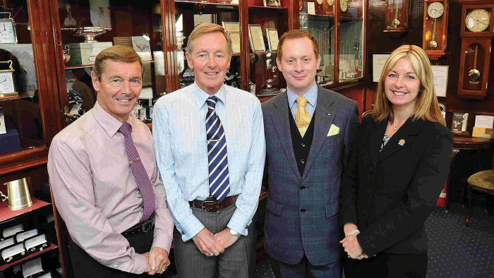 Family affair: W Carter & Son is now owned by the Holmeses and still sells from its Tudor shop