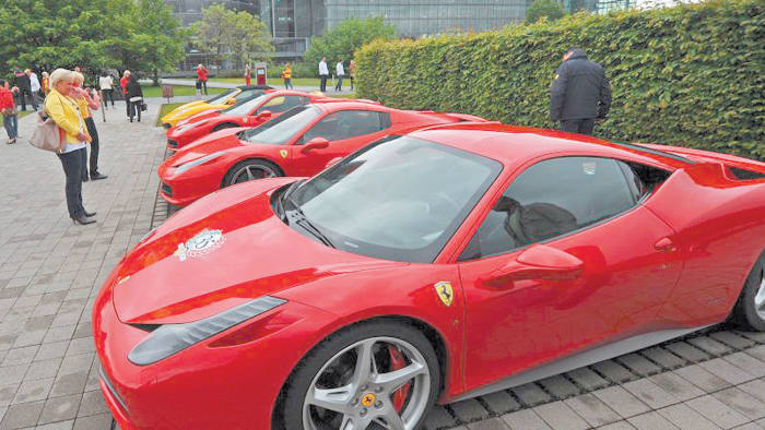 Ferraris are parked in a row during a meeting of the German Ferrari Club in Dresden, eastern Germany on May 31, 2013