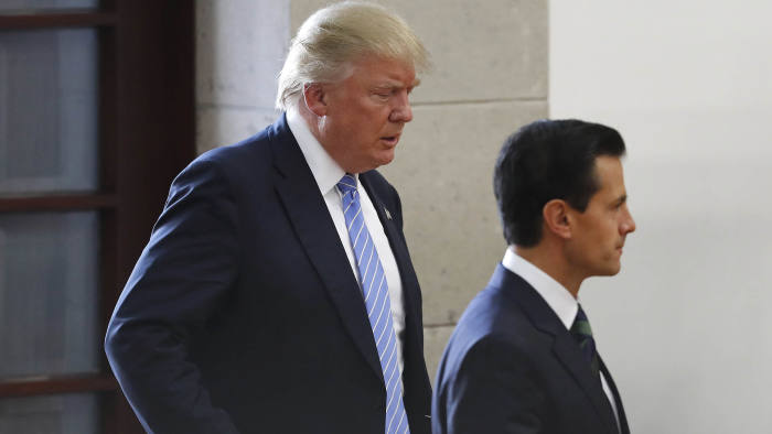 Republican presidential nominee Donald Trump, left, walks behind Mexico's President Enrique Pena Nieto as they arrive to deliver statements to the press in Mexico City, Wednesday, Aug. 31, 2016. Trump is calling his surprise visit to Mexico City a 'great honor.' The Republican presidential nominee said after meeting with Peña Nieto that the pair had a substantive, direct and constructive exchange of ideas.(AP Photo/Dario Lopez-Mills)
