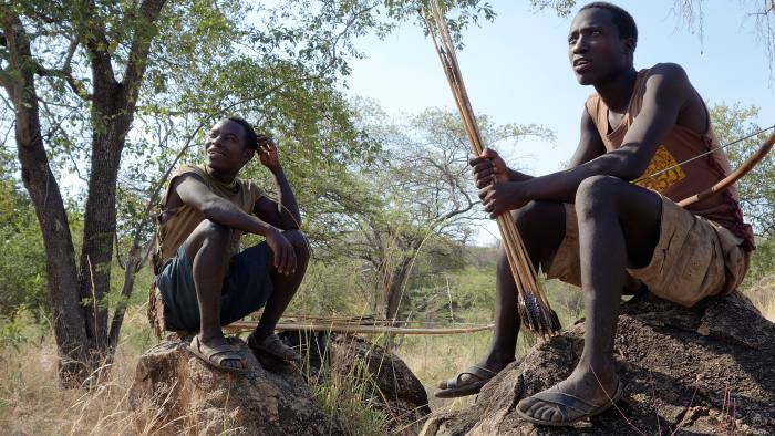 Mwapo and Musa rest while hunting