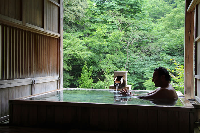 Guide Sakis Mits in the 'onsen' at Kayotei