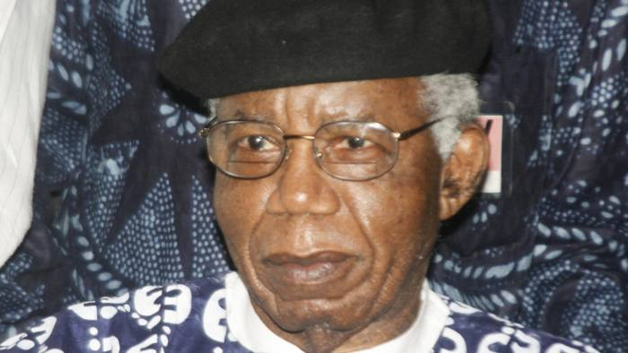 """Nigerian writer, 70, Chinua Achebe is pictured on January 19, 2009 during a welcoming ceremony at Nnamdi Azikiwe International Airport in Abuja upon his return to Nigeria for the firrst time in over 10 years. Achebe, whose most famous work is 1958's """"Things Fall Apart,"""" is a literature professor at Bard College in New York state. AFP PHOTO / Abayomi Adeshida (Photo credit should read ABAYOMI aDESHIDA/AFP/Getty Images)"""