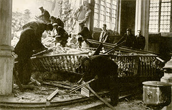 The damaged All Hallows by the Tower church after a bomb fell on the East Wall in 1940