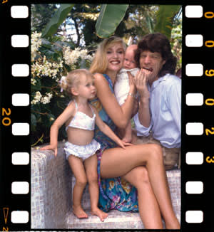 Jerry Hall, Mick Jagger and two of their children, Barbados, c1985