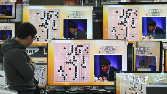 South Korean professional Go player Lee Sedol is seen on the TV screens during the Google DeepMind Challenge Match against Google's artificial intelligence program, AlphaGo, at the Yongsan Electronic store in Seoul, South Korea, Wednesday, March 9, 2016. Google's computer program AlphaGo defeated its human opponent, Lee, in the first game of their highly anticipated five-game match.(AP Photo/Ahn Young-joon)