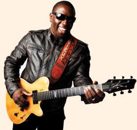 Vieux Farka Touré playing a guitar
