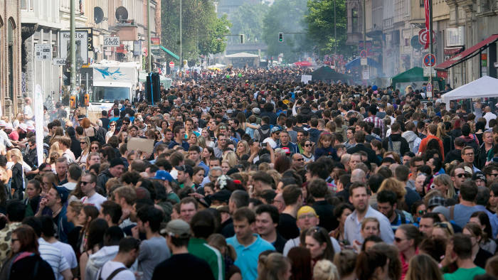 Crowds gather for a street festival in the Kreuzberg district, an area of Berlin with a large immigrant population, on May Day this year