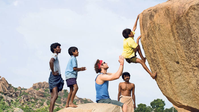 Local Indian children bouldering near the Baba Cafe in Hampi India
