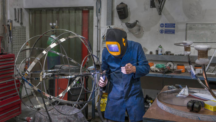 Welding sections of a stainless-steel armillary sphere sundial at David Harber's workshop