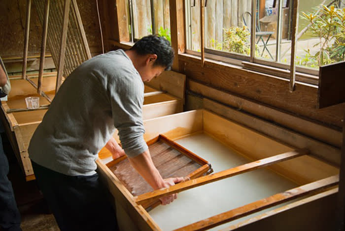 Making paper using a bamboo screen