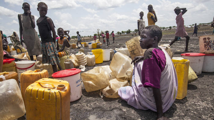 Displaced women queue to collect water from a new water point in Aburoc South Sudan on June 5, 2017. Government offensives on the West Bank of the Nile river in April and May 2017 led to the capture of several villages, including Kodok. Up to 25,000 people were displaced during these clashes, most of whom initially fled toward Aburoc. In subsequent weeks, at least 20,000 people fled to Sudan. Many of those in Aburoc walked for days on foot to reach the location without access to sufficient water due to conflict along the River Nile and arrived exhausted and weak. They are slowly now receiving help from international aid agencies. / AFP PHOTO / ALBERT GONZALEZ FARRAN (Photo credit should read ALBERT GONZALEZ FARRAN/AFP/Getty Images)
