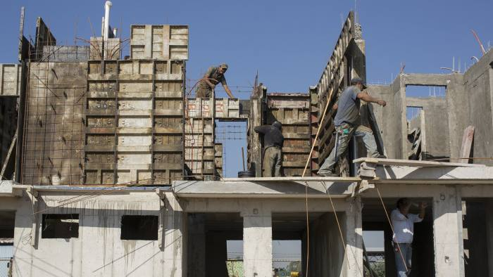 Construction workers build the second floor of a home at Servicios Corporativos Javer S.A.P.I. de C.V.'s Villas de Loreto II housing development in Tultepec, Mexico, on Thursday, Nov. 6, 2014. Servicios Corporativos Javer S.A.P.I. de C.V. reported a 17.9 percent increase in the number of homes titled and a 20.3 percent increase in net revenue in a third-quarter earnings announcement last month. Photographer: Susana Gonzalez/Bloomberg