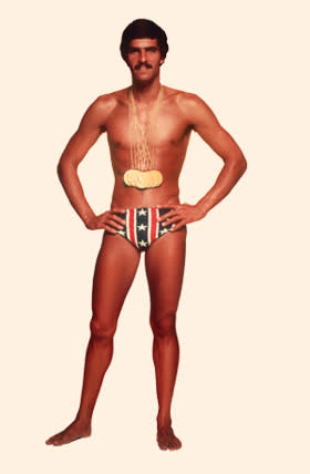 American swimmer Mark Spitz, circa 1973, with the seven gold medals that he won at the 1972 Munich Olympic Games