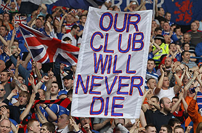 Fans hold a banner at a Rangers v Celtic match in March 2012
