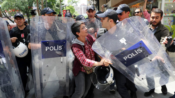 TOPSHOT - Riot police intervene to stop protesters demonstrating in support of two hunger-strikers who were taken into custody in May, in the Turkish capital Ankara on June 3, 2017. A pair of Turkish educators are facing months or even years in prison after being arrested for launching a hunger strike in protest at being sacked from their jobs in a widespread purge following last year's failed coup attempt. Nuriye Gulmen and Semih Ozakca have not eaten in 77 days and their hunger strike has become a rallying point for opponents of the government of President Recep Tayyip Erdogan. / AFP PHOTO / ADEM ALTANADEM ALTAN/AFP/Getty Images