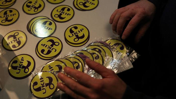 ROCHESTER, ENGLAND - NOVEMBER 13:  A United Kingdom Independence Party (UKIP) volunteer gets ready to send out car stickers printed with the party's logo at their headquarters on November 13, 2014 in Rochester, England. UKIP party leader Nigel Farage and local candidate Mark Reckless are addressing a public meeting of 350 people today, as they step up campaigning in the town ahead of the by-election next week.  (Photo by Mary Turner/Getty Images)