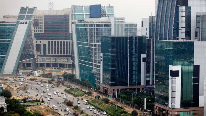Traffic passes DLF Cybercity, a 128 acre integrated business district, in Gurgaon, India