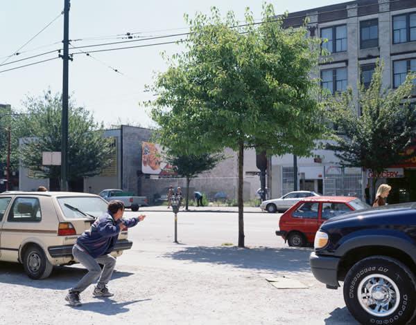 Man pretending to hold a gun aiming at a target