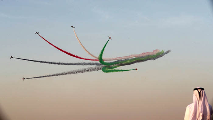 TOPSHOT - UAE's Al-Fursan display team perform during the Dubai Airshow on November 14, 2017, in the United Arab Emirates. / AFP PHOTO / KARIM SAHIBKARIM SAHIB/AFP/Getty Images