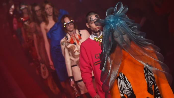 aa9ff71e4a06 Gucci fashions its reinvention in style.