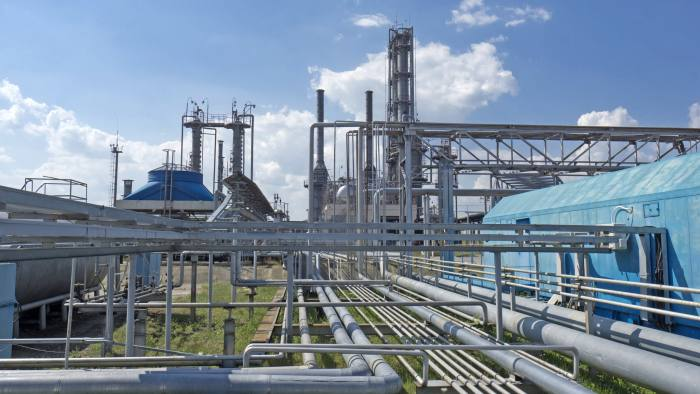 Gas transport pipes and processing infrastructure stands at a refinery operated by DK Ukrgazvydobuvannya (UGV), a unit of NAK Naftogaz Ukrainy, in Poltava, Ukraine, on Friday, July 21, 2017. Investors wanting to take the temperature of Ukraine's reform drive could do worse than look in on state-run energy firm Naftogaz, where a battle for control underscores the obstacles hampering wider efforts to clean up the ex-communist economy. Photographer: Vincent Mundy/Bloomberg
