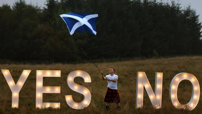 Previously unreleased photo dated 15/09/14 of businessman Jon Gamble from go2eventhire as he asks the question YES or NO with illuminated signs near Dunblane, Scotland, ahead of voting in the Scottish Referendum on September 18th. PRESS ASSOCIATION Photo. Issue date: Wednesday September 17, 2014. See PA story REFERENDUM Main. Photo credit should read: Andrew Milligan/PA Wire