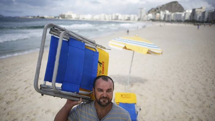 Wanderson da Silva Araújo, 38, who rents out chairs on the beach, poses on the Copacabana beach in Rio de Janeiro in this April 12, 2016.
