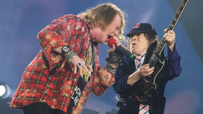 Axl Rose, left, with Angus Young at Queen Elizabeth Olympic Park. Photo: Brian Rasic/WireImage