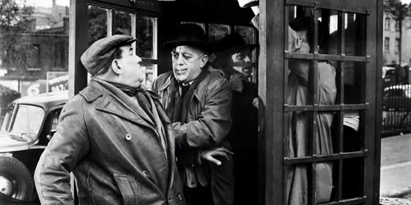 Danny Green, Alec Guinness, Herbert Lom and a red telephone box in the 1955 film 'The Ladykillers'
