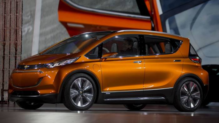 Inside The 2015 North American International Auto Show (NAIAS)...The General Motors Co. (GM) Chevrolet Bolt concept vehicle is unveiled during the 2015 North American International Auto Show (NAIAS) in Detroit, Michigan, U.S., on Monday, Jan. 12, 2015. General Motors is unveiling a new version of its plug-in hybrid Chevrolet Volt as gas hovers near $2 a gallon and the number of buyers who want a fuel-sipping vehicle shrinks. Photographer: Andrew Harrer/Bloomberg