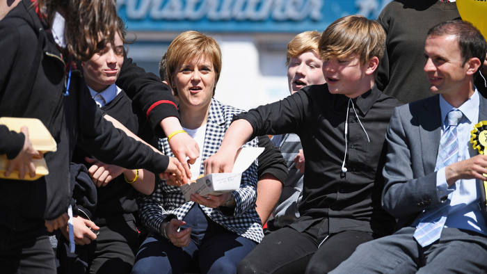 ANSTRUTHER, SCOTLAND - MAY 31: SNP leader Nicola Sturgeon shares her chips with some local school children as she campaigns with candidate Stephen Gethins on May 31, 2017 in Anstruther, Scotland. The First Minister launched the party manifesto yesterday outlining plans to boost jobs, support businesses, and make work fair if people vote for the SNP on June the 8th. (Photo by Jeff J Mitchell/Getty Images) ***BESTPIX***