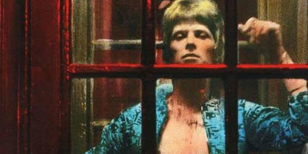 David Bowie poses in a phone box off Regent Street for the cover of his 1972 album 'The Rise and Fall of Ziggy Stardust and the Spiders from Mars'