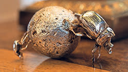 A silver dung beetle made by Patrick Mavros