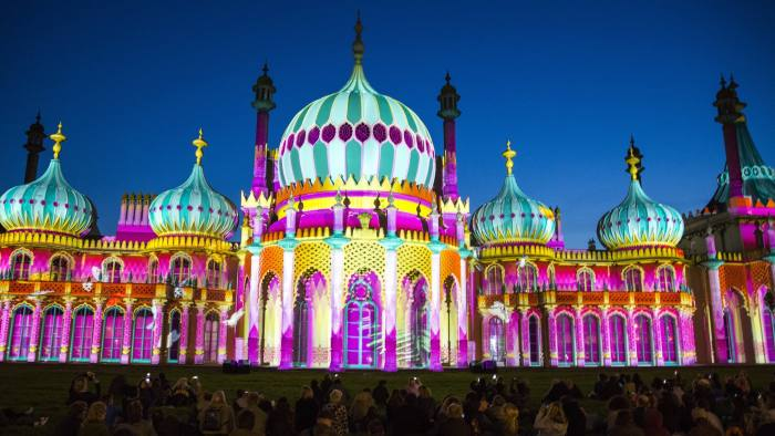 Locals enjoying Brighton Royal Pavilion lit up for the Brighton festival 2016 by Dr Blighty projections on the 25th of May 2016 in Brighton, United Kingdom.  A major outdoor event in the Royal Pavilion Garden inspired by the story of the thousands of Indian soldiers who were treated in the temporary military hospital housed in Brighton Pavilion. (photo by Andrew Aitchison / In pictures via Getty Images)