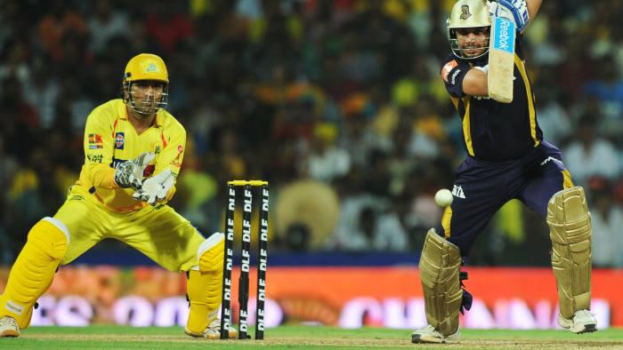 Kolkata Knight Riders batsman Manvinder Bisla is watched by Chennai Super Kings captain Mahendra Singh Dhoni