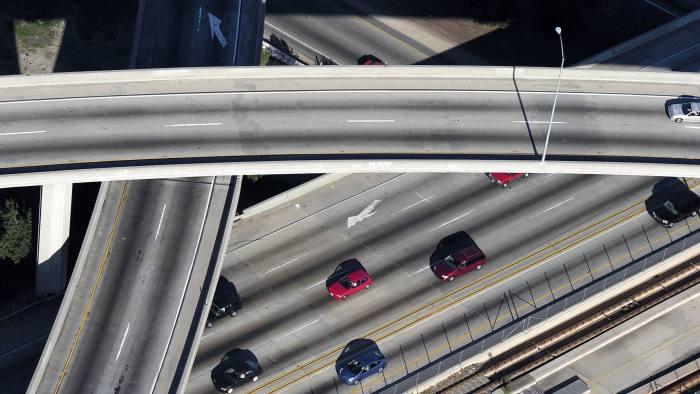 Los Angeles freeway aerial.  Merging lanes, ramps and bridges in afternoon light.