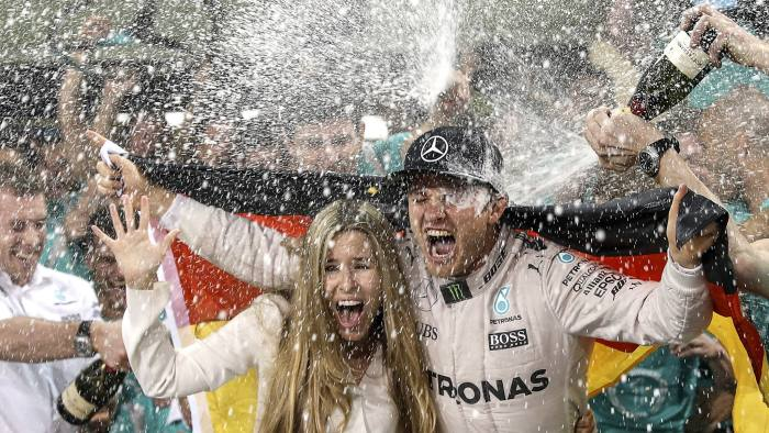 epa05656678 (FILE) A file picture dated 27 November 2016 of German Formula One driver Nico Rosberg (R) of Mercedes AMG GP celebrating with his wife Vivian Sibold (L) after winning the Formula One World Championship 2016 at Yas Marina Circuit in Abu Dhabi, United Arab Emirates. Formula One 2016 World Champion Nico Rosberg announced on 02 December 2016 his immediate retirement from Formula One after claiming his first F1 world championship title at the final race of the 2016 season, the Abu Dhabi Grand Prix. EPA/SRDJAN SUKI