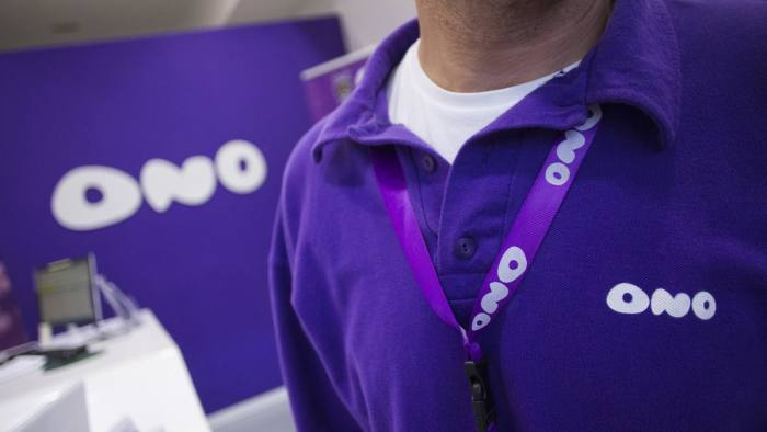 A logo sits on an employee's polo shirt inside a Grupo Corporativo ONO SA store in Parquesur shopping mall, operated by Unibail-Rodamco SE, in Leganes, Spain, on Tuesday, Nov. 19, 2013. Vodafone Group Plc's $30 billion cash hoard is fueling speculation that it may purchase Grupo Corporativo ONO SA, causing the perceived creditworthiness of the Spanish cable operator to increase more than any other company in Europe