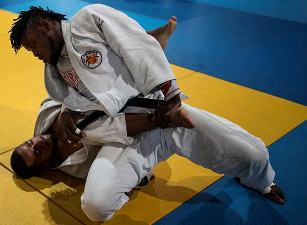 Refugee and judo athlete Popole Misenga (right) from Democratic Republic of Congo fights during a training session ahead of the Rio Olympics
