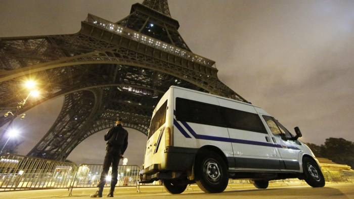 Paris attacks aftermath...epaselect epa05025810 A police officers stands guard at the foot of the Eiffel Tower in Paris, France, 14 November 2015. At least 129 people have been killed in a series of attacks in Paris, France on late 13 November 2015, according to French officials. Eight assailants were killed, seven when they detonated their explosive belts, and one when he was shot by officers, police said. EPA/MALTE CHRISTIANS