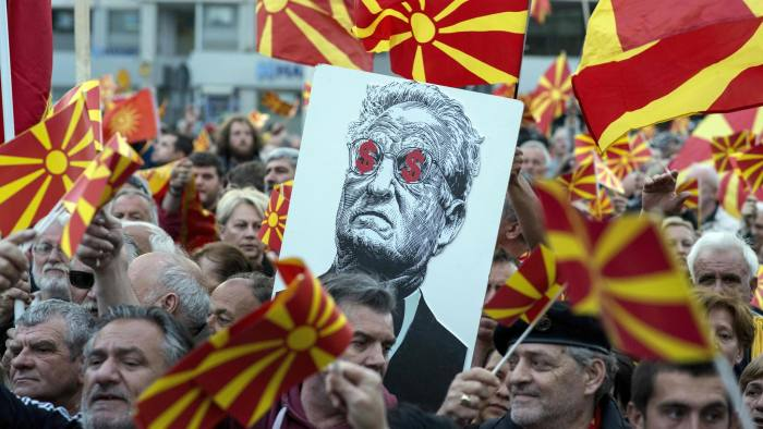 TOPSHOT - People hold a placard dipicting billionaire George Soros during a demonstration against a deal between Social Democrats and the Albanian Democratic Union for Integration, about a law making Albanian the second official language, on March 30, 2017 in Skopje. / AFP PHOTO / Robert ATANASOVSKI (Photo credit should read ROBERT ATANASOVSKI/AFP/Getty Images)
