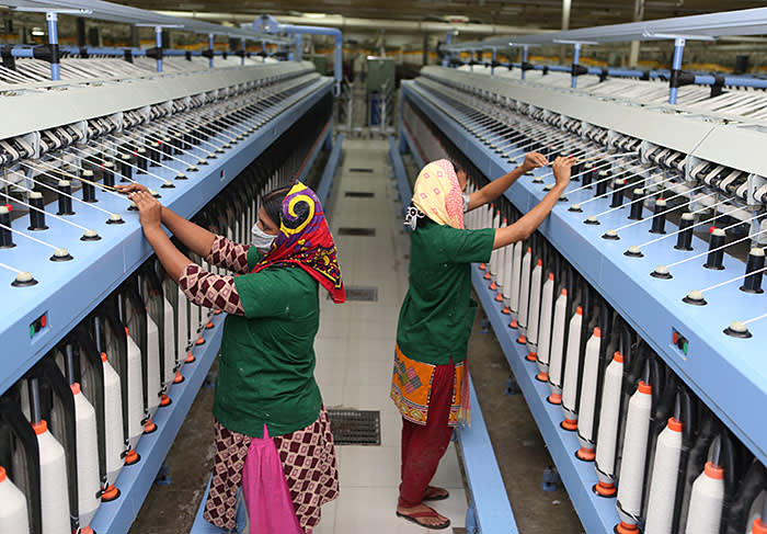 Female workers in a ready made garment factory on December 13, 2016 in Gazipur, Bangladesh. Bangladesh is the second largest apparel exporter in the world after China. (Photo by Shafiqul Alam/Corbis via Getty Images)