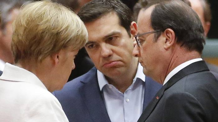epa04843942 Greek Prime Minister Alexis Tsipras (C) talks with German Chancellor Angela Merkel (L) and French President Francois Hollande at the start of eurozone leaders' summit on the Greek crisis at the European Council headquarters in Brussels, Belgium, 12 July 2015. Greece is teetering on the edge of default, cut off from bailout aid, in arrears to the International Monetary Fund (IMF), owing large debt repayments this month and fending off suggestions that it could soon exit the eurozone. EPA/OLIVIER HOSLET