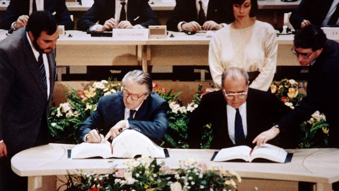 French foreign minister  Roland Dumas and French economy minister Pierre Bérégovoy sign the Maastricht  Treaty, which led to the creation of the euro, on February 7, 1992.